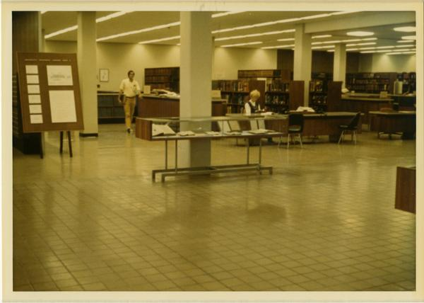 View of stacks and reference desk in University Research Library, ca. 1964