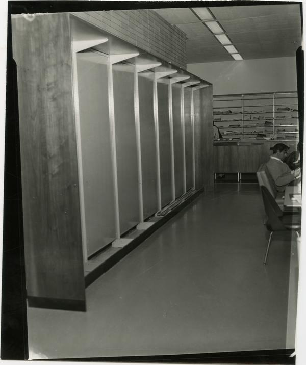 Contact print of patrons working at desk in University Research Library, ca. 1964