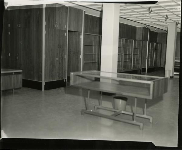 Contact print of empty display cases in University Research Library
