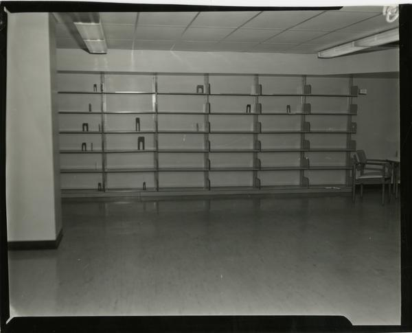 Contact print of empty shelving in University Research Library