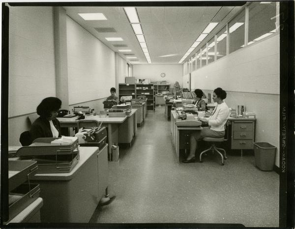 Contact print of University Research Library staff working at their desks