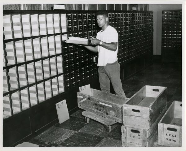 Man packing up card catalog in preperation for University Research Library move, 1964