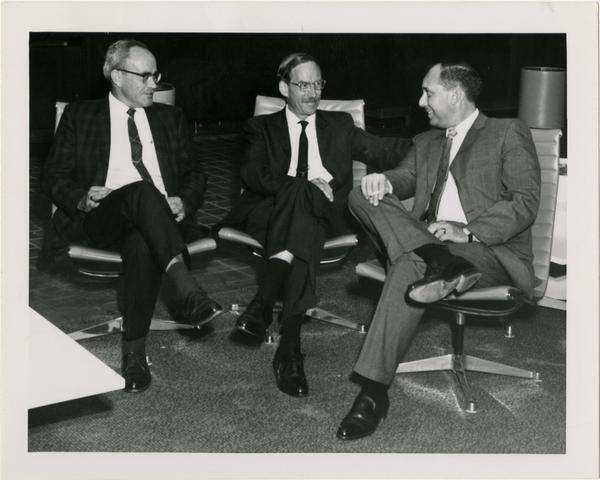 Mr. Miles and Mr. Vosper with unidentified man at University Research Library Open House, 1964
