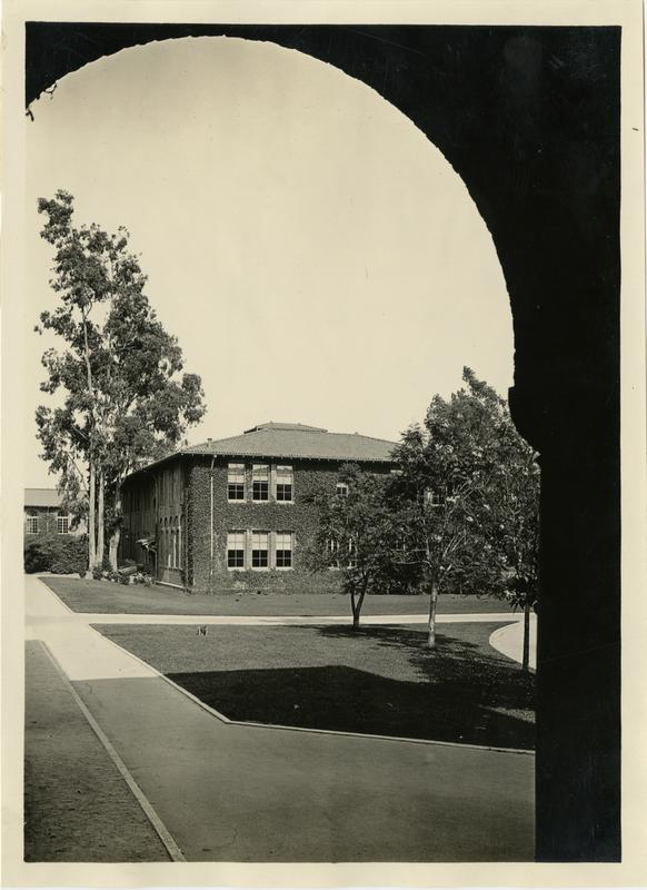 Looking towards building through arches on Vermont Ave campus