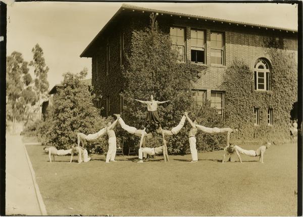 Vermont Ave campus gymnastics team posing in formation