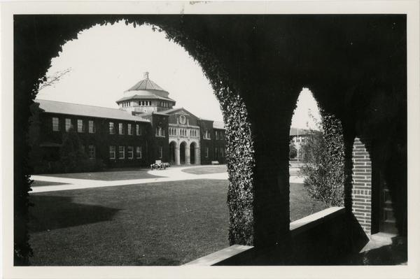 Millspaugh Hall through the arches on Vermont Ave campus