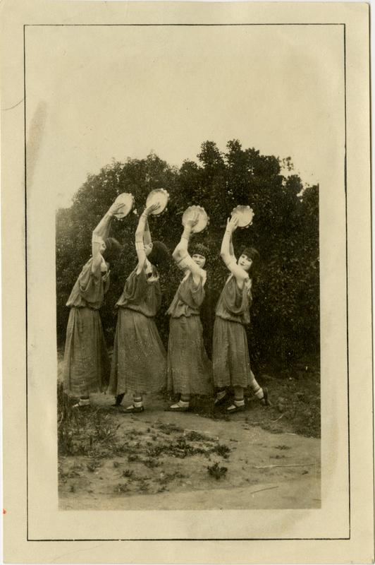 Students in pageant costumes pose on Vermont Ave campus, 1922