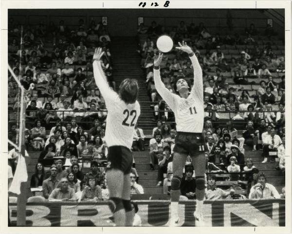 UCLA volleyball players setting up a shot during a game