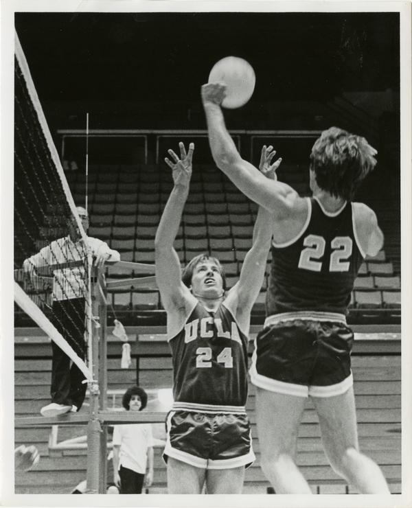 Two-time UCLA letterman Dave Olbright(24) sets up by Singin Smith, another two-time letterman in a 1978 early-season volleyball match.