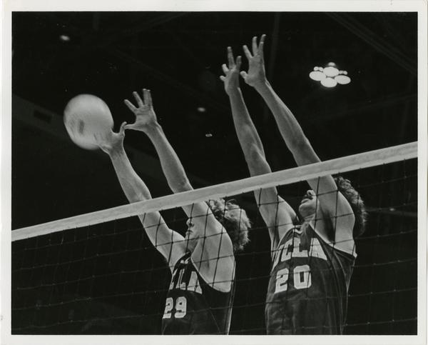 UCLA's Steve Salmons (29) and K.C. Keller (20) go up for a block during a 1978 early-season Bruin volleyball match.