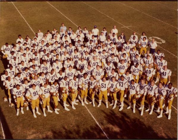 Group portrait of UCLA Football team and coaching staff