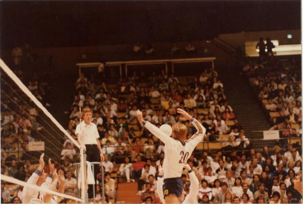 Two UCLA volleyball players setting upa shot during a game, 1983