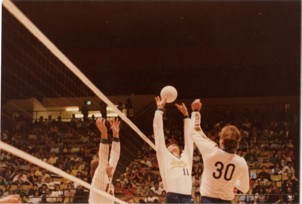 UCLA volleyball player setting the ball during a game, 1983