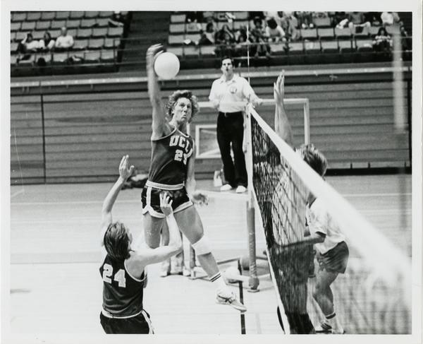 UCLA volleyball player about to spike the ball during a game, 1983