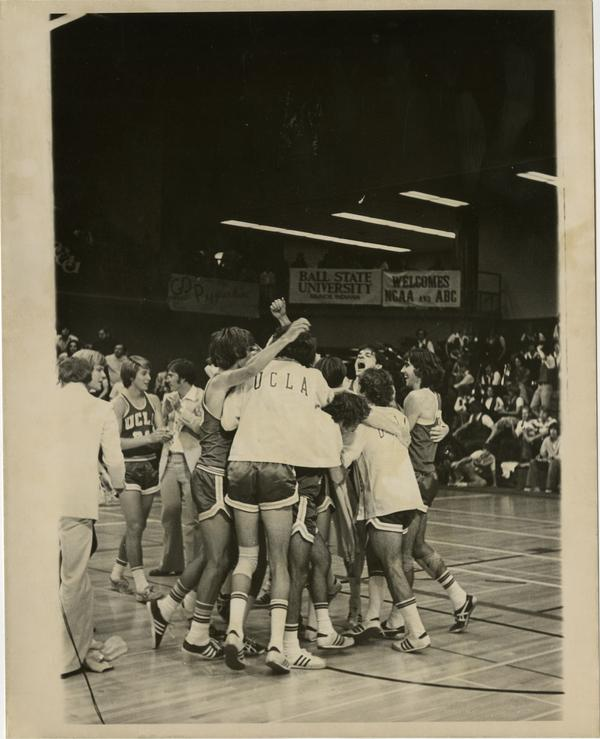 UCLA volleyball team celebrating victory after a game