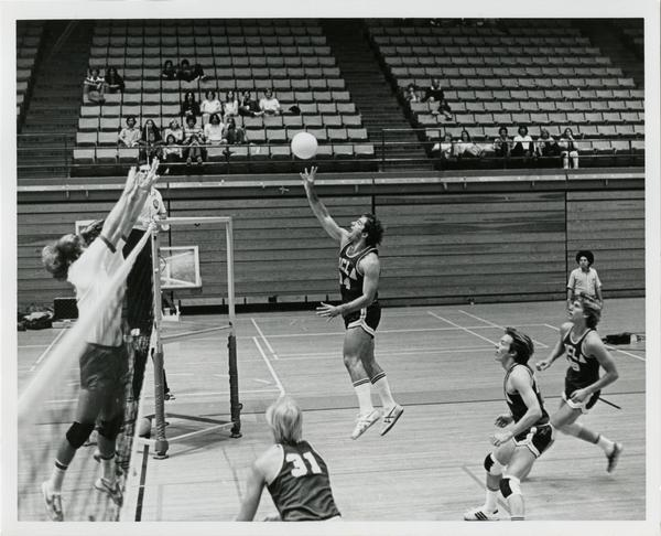 UCLA volleyball player reaching for ball during a game
