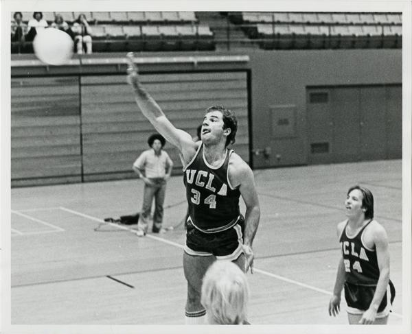UCLA volleyball player hitting the ball during a game
