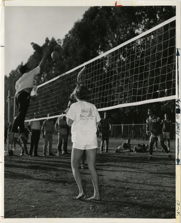 Volleyball player spiking the ball over the net during Intramural game