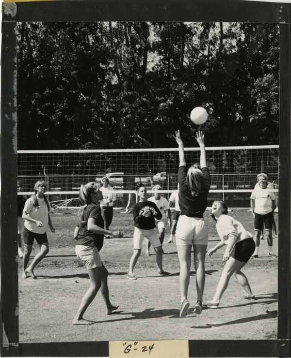 Volleyball player reaching for the ball during an intramural volleyball game