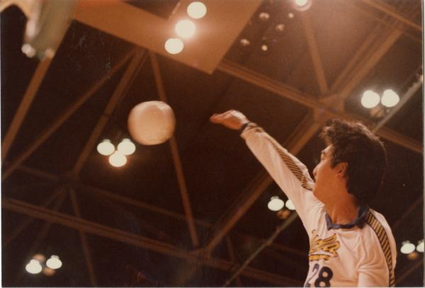 UCLA volleyball player hitting the ball during a game, 1983