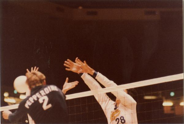 UCLA volleyball player blocking a shot during a game, 1983