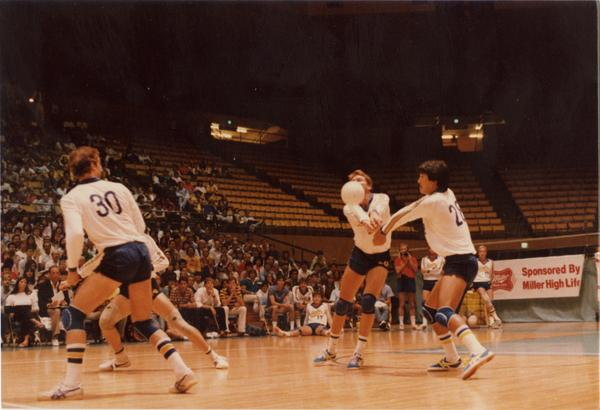 UCLA volleyball players hitting the ball during a game, 1983