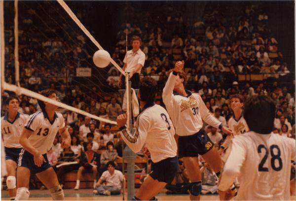 UCLA volleyball player after hitting the ball during a game, 1983