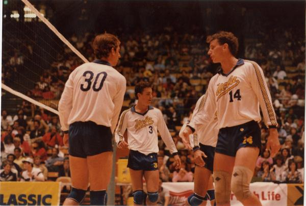 UCLA volleyball team speaking to each other during a game, 1983