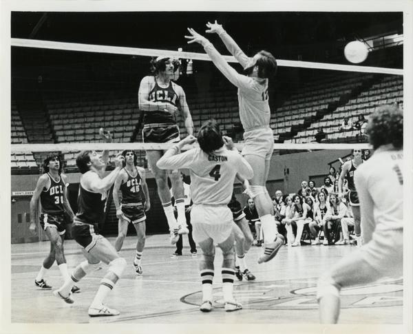 UCLA volleyball player, David Olbright setting the ball for hitter, Mike Gottschal