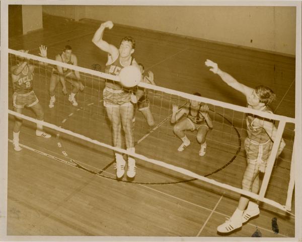 Action shot of UCLA Volleyball team: Eddie Machado, Micke McCann, George Conkey, Steve Freitzen, and Dale Eicks