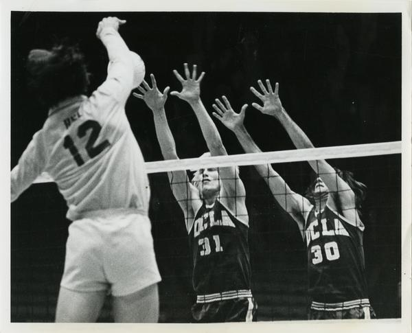 UCLA Volleyball players, Doug Rabe and Fred Sturm blocking against CSULB
