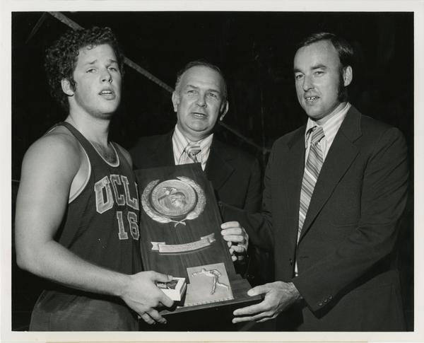 UCLA Volleyball player, Dick Irvine, holding 1972 NCAA championship award with Walter Versen and Al Scates