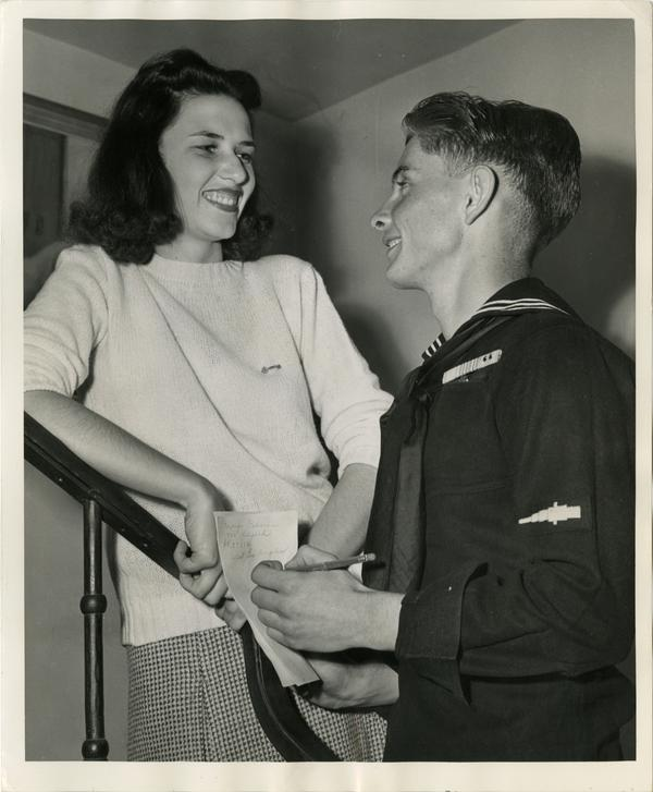 H. R. Tubbs, coxswain, USN, a newly enrolled V-12 student at UCLA, gets the phone number and address of Marjorie Osborne
