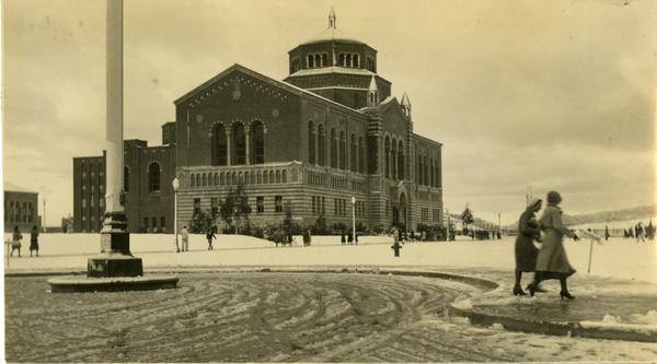 Campus Snow Scene with Co-Eds and Powell Library, 1932
