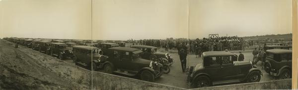 Panoramic view of cars parked along road for UCLA campus groundbreaking, October 1926
