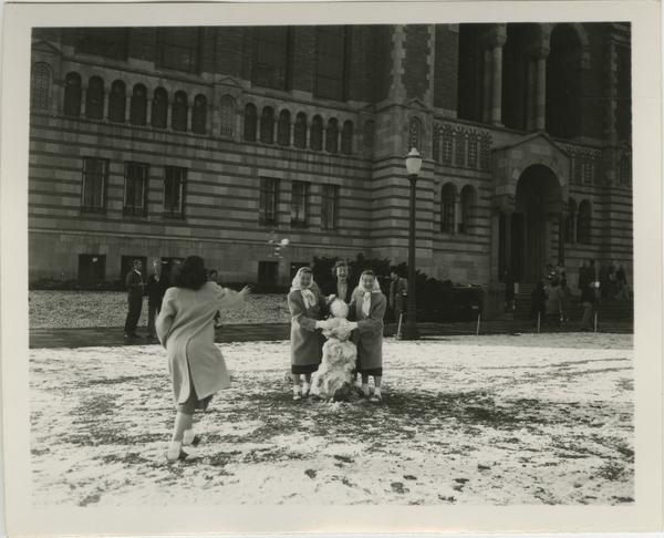 Campus Snow Scene with Female Students and Snowman in Front of Powell Library, 1932 Jan. 15