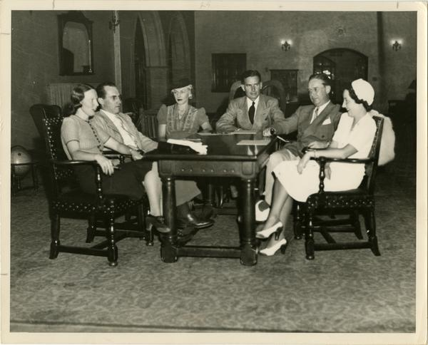 The 1929 Class Officers sit around a table