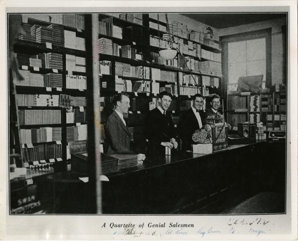 Four clerks behind the counter at the Bookstore on the Vermont Campus