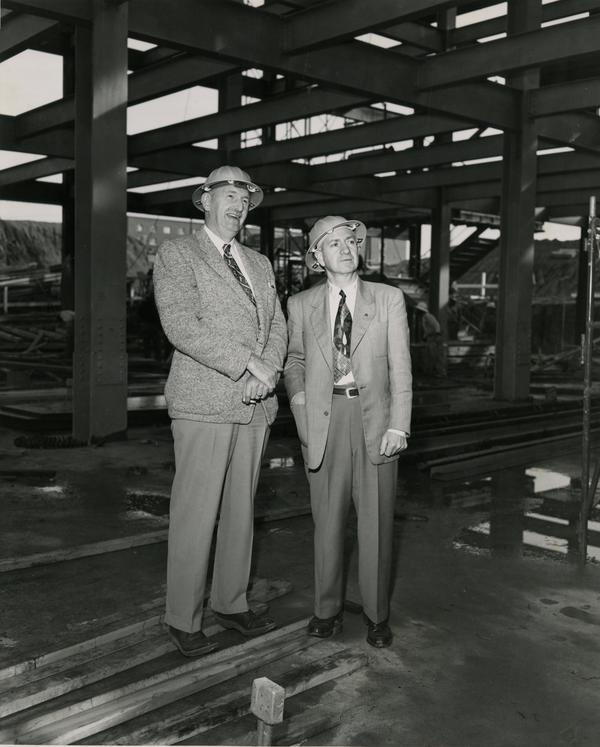 Two members of the construction inspection team pose for a photo at the construction site of the UCLA medical center, c. 1951