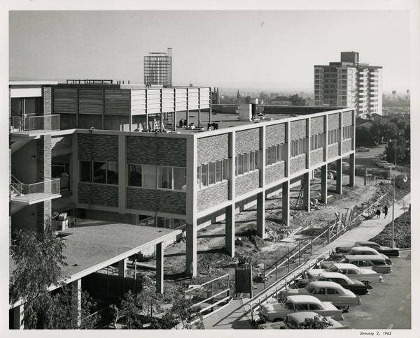 The UCLA medical center after construction completed with a full parking lot, 1960