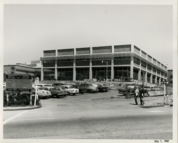 UCLA medical center with cars parked in the parking lot, 1962