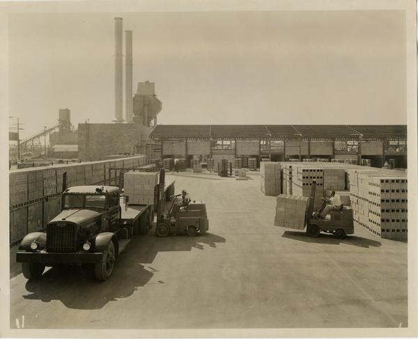 Trucks transporting cinder blocks for construction of the medical center