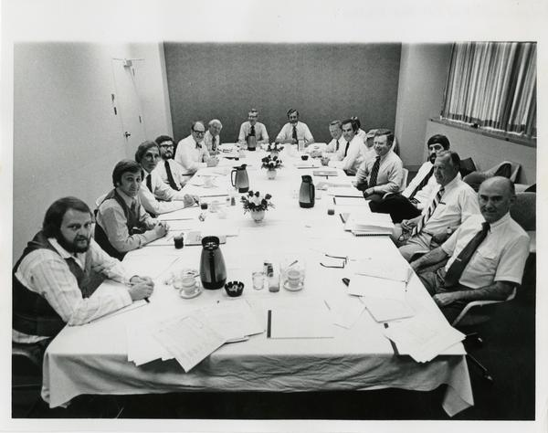 The medical center board of visitors sitting down for a meal, c. 1977