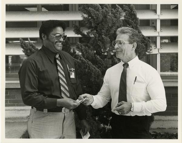 Aaron Lohn and T.W. Jones shaking hands outside the medical center