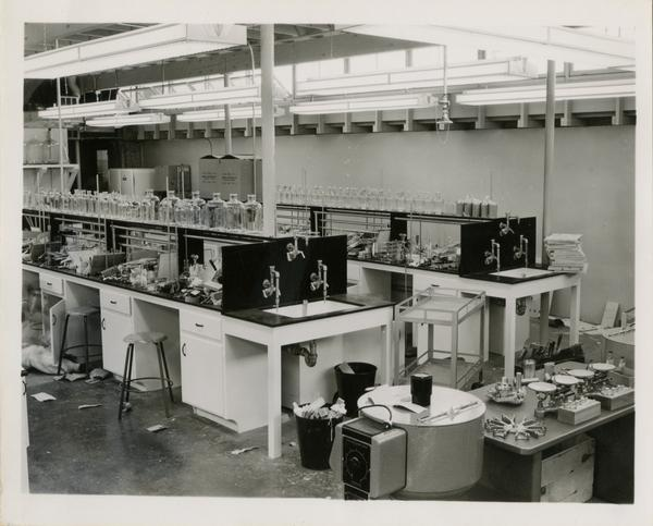 Shot of a messy medical school laboratory, 1955