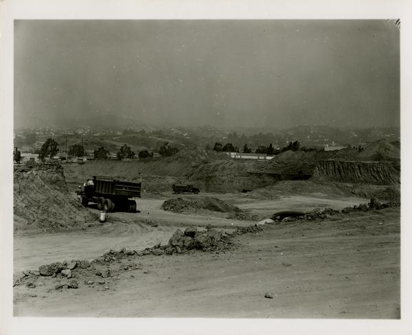 The site of the medicine school with construction trucks driving through before construction has started