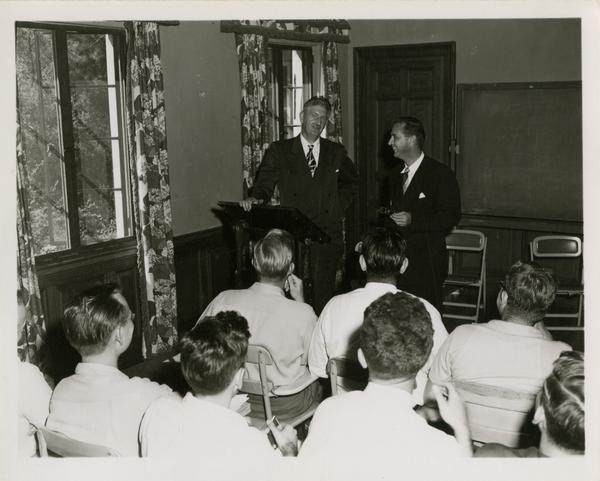 Two men address a crowd of medical school students, 1955