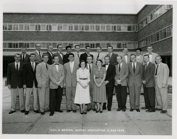 Group photo of the medical school graduating class in front of one of the medical school buildings, 1955