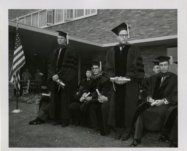 Graduate students of the medical school sitting together after the ceremony, 1956