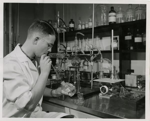 Ove Alfred Nedergaard, research assistant at the Department of Pharmacology sitting at a work station, May 1955
